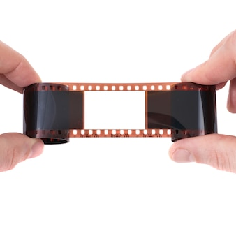 Stary film z pustą ramką na białym tle