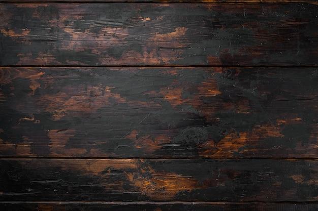 Stary grunge ciemny teksturowane tło drewniane zestaw, widok z góry płasko leżał, z kopią miejsca na tekst lub jedzenie stary ciemny drewniany stół tło