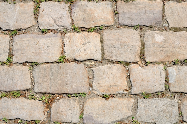 Stary kamienny drogowy tło