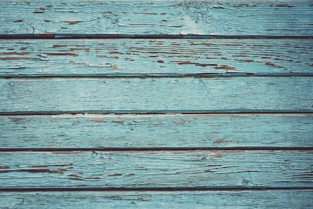 Stary malujący drewniany ogrodzenie, deski tekstura, szalunku tło. grunge niebieskie tablice.