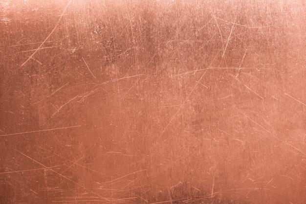Stary metalowy talerz, szczotkowana tekstura miedzi, brązowe tło