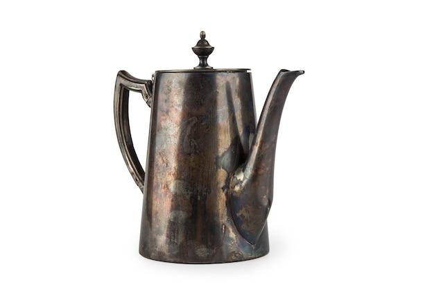 Stary mosiężny dzbanek do kawy izolować na białym tle