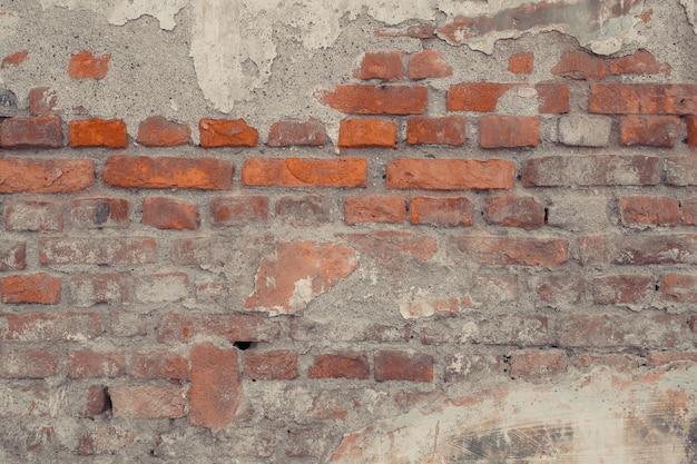 Stary mur z cegły tło wykonane z cegieł tekstura powierzchni ściany