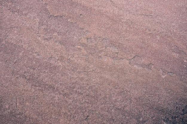 Stary piasek kamiennej ściany tekstury tło. abstrakcyjny