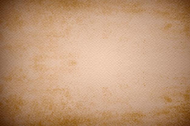 Stary poplamiony papier teksturowany tło