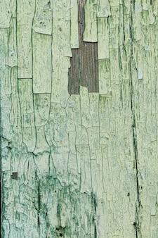 Stary porysowany zielony drewniany tło