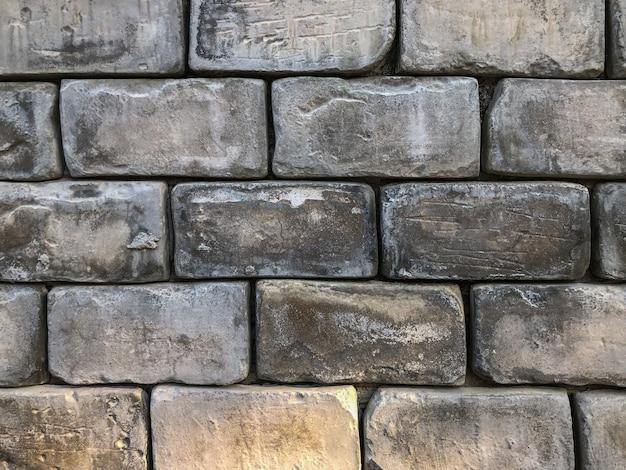 Stary ściana z cegieł tło z światła dziennego światłem