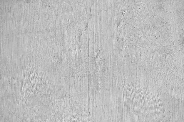 Stary ścienny tekstury tło z szczotkarskimi uderzeniami