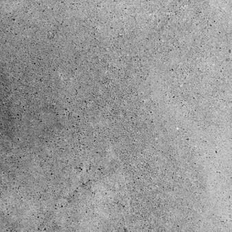 Stary szary betonowy mur na tle