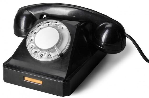 Stary telefon odizolowywający na białym tle
