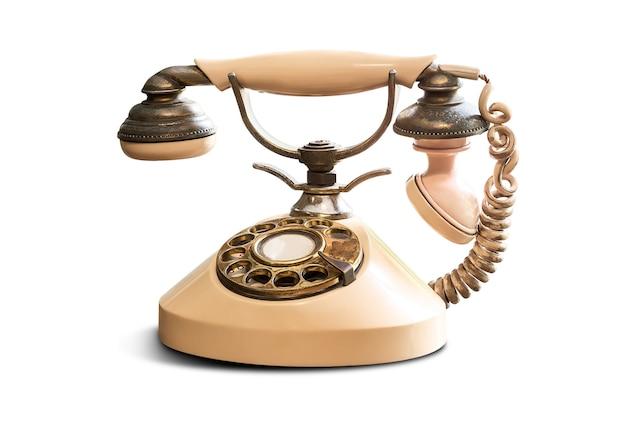 Stary telefon vintage na białym tle