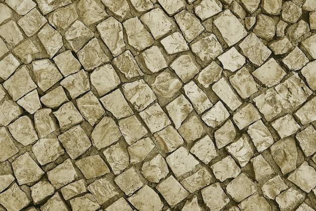 Stary tło beżowy kamień bruk