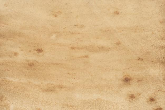 Stary tło grunge brązowego papieru. streszczenie tekstura kolor płynnej kawy.