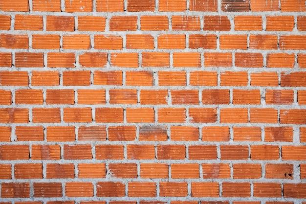 Stary tło ściana z czerwonej cegły