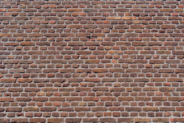 Stary tło ściany z czerwonej cegły