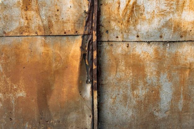 Stary zardzewiały metaliczny tło