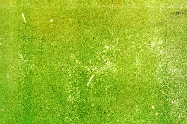 Stary zielony brudny papier tekstury z zadrapaniami. abstrakcyjne tło