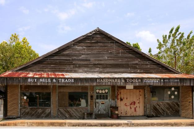 Starzejący się rocznika grunge drewniany teksas sklep