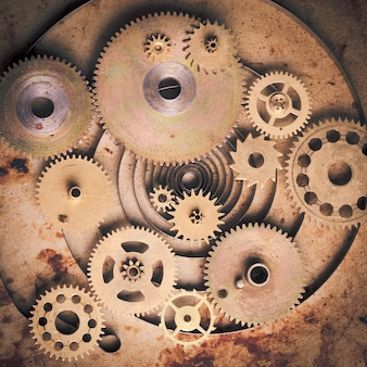 Steampunk tło z mechanicznych zegarów szczegóły na starym metalowym tle. wewnątrz zegara koła zębate