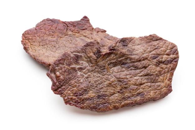 Steki wołowe z grilla bio z przyprawami na białym tle