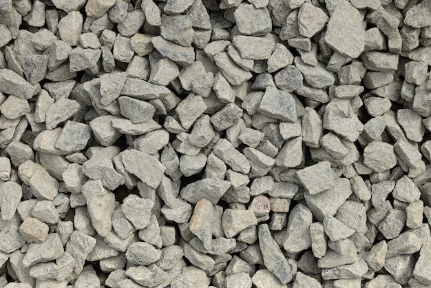 Sterta pokruszonego kamienia lub kanciastej skały jako tekstury lub tła