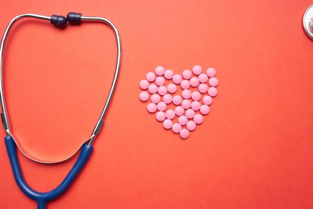 Stetoskop medycyna leczenie farmaceutyczne pomarańczowe tło