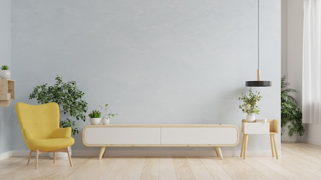 Stojak tv w nowoczesnym salonie, wnętrze jasnego salonu z fotelem na pustej niebieskiej ścianie