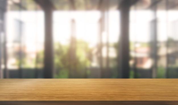Stół w tle miasta nowoczesnego biura z pustą przestrzenią do kopiowania na stole do makiety wyświetlania produktów