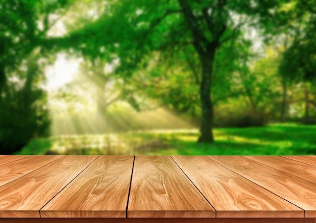 Stół w zieleni rozmycia z pustą przestrzenią na stole do makiety wyświetlania produktu.