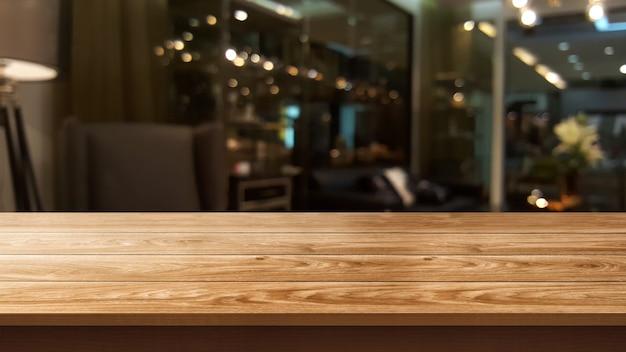 Stół z drewna w rozmytym tle nowoczesnej restauracji lub kawiarni do makiety wyświetlania produktu