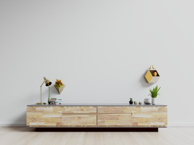 Stolik pod telewizor, szafka pod telewizor w nowoczesnym pustym pokoju, biała ściana.