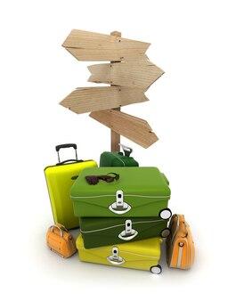 Stos bagażu i rustykalny drewniany znak z dużą ilością miejsca na kopię