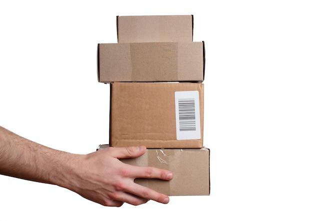 Stos kartonów w męskiej dłoni.