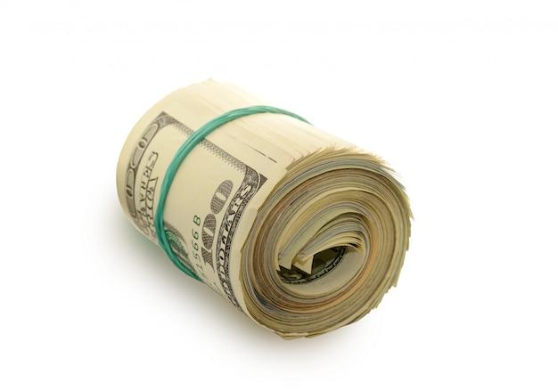 Stos pieniędzy dolarów ograniczone przez gumkę.