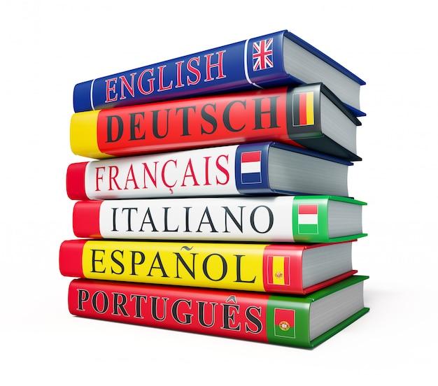 Stos słowników na białym tle