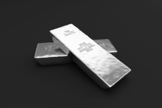 Stos srebrnych sztabek na czarnym tle