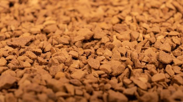 Stos tekstury tła granulek kawy rozpuszczalnej