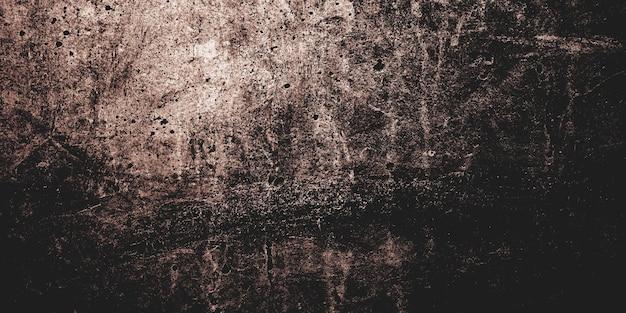 Straszny ciemny cement na tło. ściany są pełne plam i zadrapań.