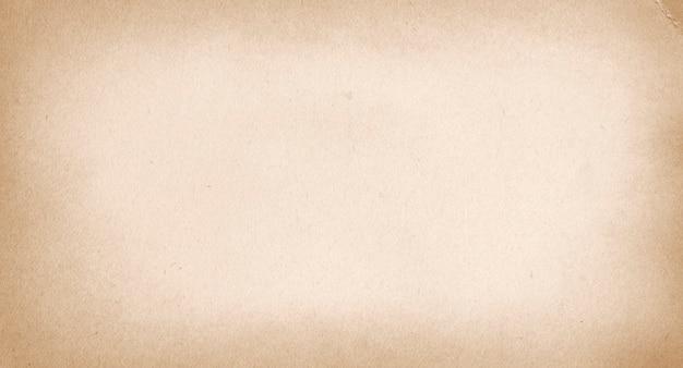 Streszczenie antyczne beżowe tło, papier pakowy z recyklingu, pusty brązowy karton do projektowania, grunge