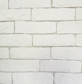 Streszczenie białe tło cegła.