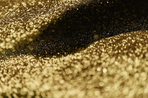 Streszczenie bokeh światło na złotym eleganckim tle