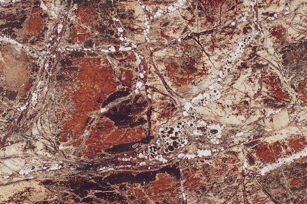 Streszczenie brązowy wzór płyty marmurowej. płytka powierzchni podłogi.