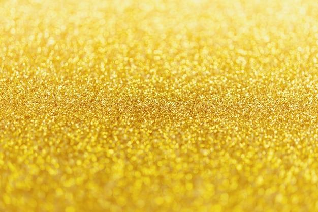 Streszczenie brokat złoty blask z jasnym tle bokeh