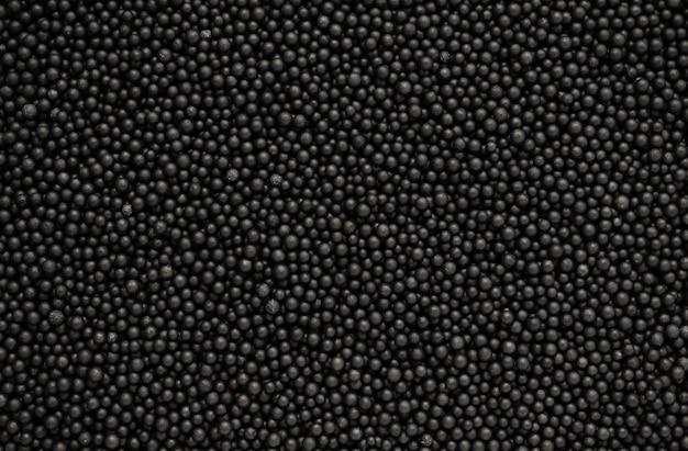 Streszczenie czarne piankowe koraliki tekstury tła
