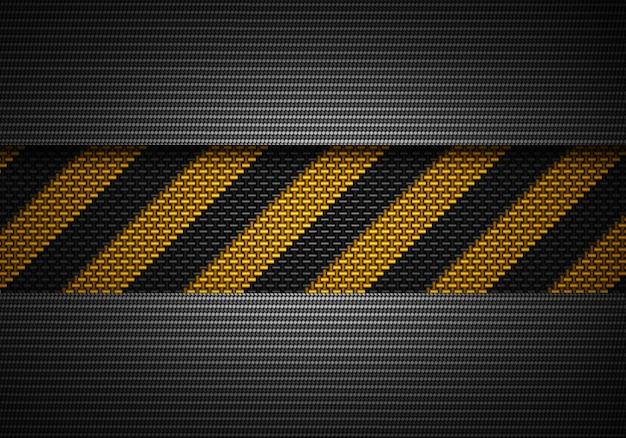 Streszczenie czarny materiał teksturowanej węgla z taśmy ostrzegawczej