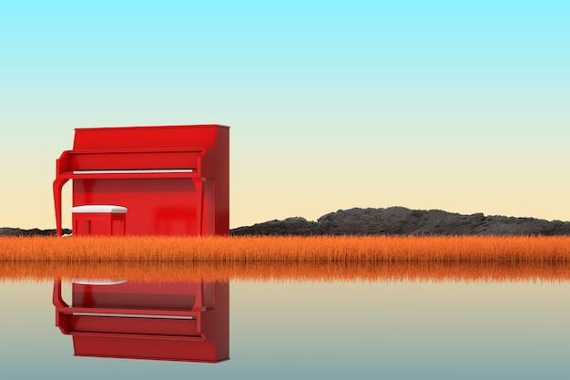 Streszczenie czerwony fortepian stojący w jesieni długiej trawy na skrajnym zbliżenie brzegu rzeki. renderowanie 3d