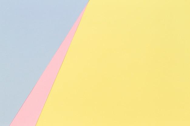 Streszczenie geometryczny kształt pastelowy żółty różowy i niebieski kolor tła papieru