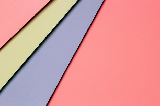 Streszczenie kolorowego papieru tekstury ściany. minimalistyczne geometryczne kształty i linie w jasnoniebieskich, pastelowych różach, zieleni