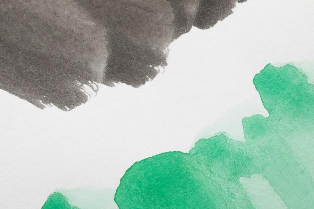 Streszczenie kontrastujących kolorów atramentu na białej powierzchni