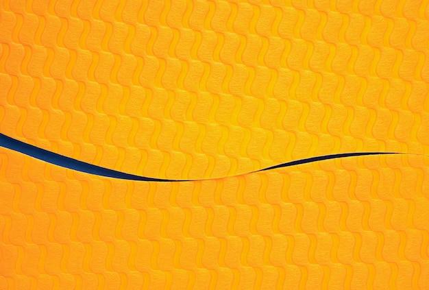 Streszczenie krzywa pomarańczowy z niebieskim kolorem papieru tekstury tła